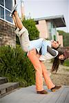 Woman Lifting Friend on her Back    Stock Photo - Premium Rights-Managed, Artist: Ty Milford, Code: 700-02121684