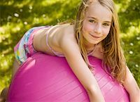 Portrait of young blonde girl lying on pink ball smiling    Stock Photo - Premium Rights-Managednull, Code: 822-02124280