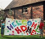 Portrait of two young childrend holding colourful welcome home sign    Stock Photo - Premium Rights-Managed, Artist: ableimages, Code: 822-02124615