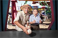 Couple at Amusement Park, Santa Monica Pier, Santa Monica, California, USA    Stock Photo - Premium Rights-Managednull, Code: 700-02125368