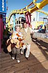Couple at Amusement Park, Santa Monica Pier, Santa Monica, California, USA    Stock Photo - Premium Rights-Managed, Artist: Blue Images Online, Code: 700-02125369