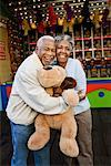 Couple Hugging and Holding Stuffed Toy, Santa Monica Pier Amusement Park, California, USA