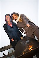 sweater and fireplace - Two Women Roasting Marshmallows Over Fire    Stock Photo - Premium Rights-Managednull, Code: 700-02125539