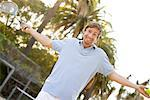 Man Shrugging Holding Tennis Racquet and Ball    Stock Photo - Premium Rights-Managed, Artist: Ty Milford, Code: 700-02125545