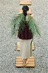 Woman standing on foothpath, carrying palm leaves behind back, rear view Stock Photo - Premium Royalty-Free, Artist: Oriental Touch, Code: 633-02128600
