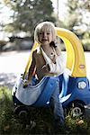 Boy with Broken Arm Playing in Toy Car    Stock Photo - Premium Rights-Managed, Artist: Derek Shapton, Code: 700-02129073