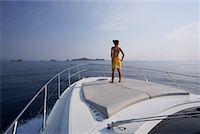 Woman Standing on Bow of Yacht, Girolata Marine Park, Corsica, France    Stock Photo - Premium Royalty-Freenull, Code: 600-02130721