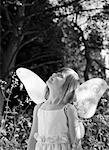 Portrait of a young girl in a fairy costume standing in a garden looking up B&W    Stock Photo - Premium Rights-Managed, Artist: ableimages, Code: 822-02137085