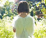 Back of a young girl in a white fairy costume standing in a garden    Stock Photo - Premium Rights-Managed, Artist: ableimages, Code: 822-02137133