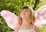 Close up of girl in a pink fairy costume looking up    Stock Photo - Premium Rights-Managed, Artist: ableimages, Code: 822-02137194