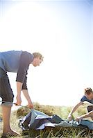 Two young campers erecting tent    Stock Photo - Premium Rights-Managednull, Code: 822-02137375