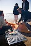 Group of friends having a barbeque on the beach    Stock Photo - Premium Rights-Managed, Artist: ableimages, Code: 822-02137437