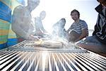 Group of friends sitting around a barbeque on the beach    Stock Photo - Premium Rights-Managed, Artist: ableimages, Code: 822-02137438