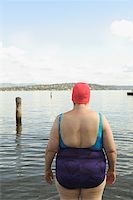fat woman in bathing suit - Rear view of a large woman in a bathing suit. Stock Photo - Premium Royalty-Freenull, Code: 673-02138103