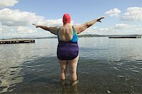 fat woman in bathing suit - Rear view of a large woman in a bathing suit. Stock Photo - Premium Royalty-Freenull, Code: 673-02138104