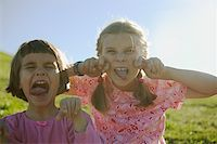Two young girls making faces. Stock Photo - Premium Royalty-Freenull, Code: 673-02138112