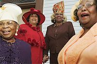 Four senior women wearing hats and singing on church steps. Stock Photo - Premium Royalty-Freenull, Code: 673-02138497