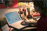 Woman working on her budget at a home office desk. Stock Photo - Premium Royalty-Free, Artist: AlaskaStock, Code: 673-02138594