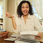 Woman working at home on personal finances. Stock Photo - Premium Royalty-Free, Artist: Science Faction, Code: 673-02138615