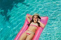 Girl talking on a mobile phone in a pool Stock Photo - Premium Royalty-Freenull, Code: 673-02138755