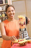 right - Woman making a blended fruit drink Stock Photo - Premium Royalty-Freenull, Code: 673-02138822