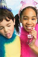 Boy and girl in party hats Stock Photo - Premium Royalty-Freenull, Code: 673-02139057