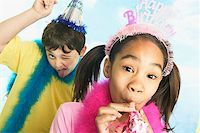 Boy and girl in party hats Stock Photo - Premium Royalty-Freenull, Code: 673-02139058