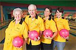 Members of a bowling team Stock Photo - Premium Royalty-Free, Artist: photo division, Code: 673-02139173