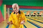 Senior man at a bowling alley Stock Photo - Premium Royalty-Free, Artist: Cusp and Flirt, Code: 673-02139194