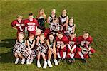 Young football players and cheerleaders