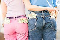 Woman taking money from man's pocket Stock Photo - Premium Royalty-Freenull, Code: 673-02139328