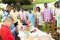 Family holding hands at picnic Stock Photo - Premium Royalty-Freenull, Code: 673-02139623