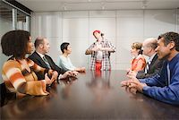 Weird co-worker at a meeting Stock Photo - Premium Royalty-Freenull, Code: 673-02139641
