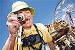 Tourist taking a photograph Stock Photo - Premium Royalty-Free, Artist: photo division, Code: 673-02139732