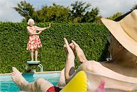Senior couple having poolside fun Stock Photo - Premium Royalty-Freenull, Code: 673-02140193