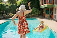 Senior couple having poolside fun Stock Photo - Premium Royalty-Freenull, Code: 673-02140198