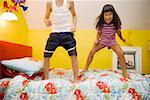 Girl and boy jumping bed Stock Photo - Premium Royalty-Free, Artist: Peter Griffith, Code: 673-02140275