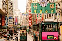 Trams and signs on busy Hong Kong street Stock Photo - Premium Royalty-Freenull, Code: 673-02140640