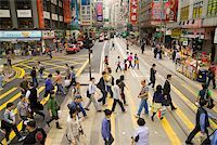 Crowded crosswalk on Hong Kong street Stock Photo - Premium Royalty-Freenull, Code: 673-02140729