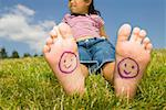 Young girl with smiley faces on bare feet Stock Photo - Premium Royalty-Free, Artist: photo division, Code: 673-02140902