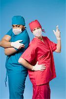 Portrait of two doctors standing back to back Stock Photo - Premium Royalty-Freenull, Code: 673-02141014