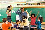 Students having paper fight in classroom