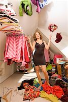Woman looking for something to wear in closet Stock Photo - Premium Royalty-Freenull, Code: 673-02142013
