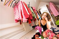 Woman looking for something to wear in closet Stock Photo - Premium Royalty-Freenull, Code: 673-02142015