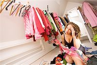Woman looking for something to wear in closet Stock Photo - Premium Royalty-Freenull, Code: 673-02142016