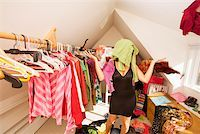 Woman looking for something to wear in closet Stock Photo - Premium Royalty-Freenull, Code: 673-02142017