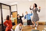 Businesspeople acting silly in office Stock Photo - Premium Royalty-Free, Artist: Uwe Umsttter, Code: 673-02142235
