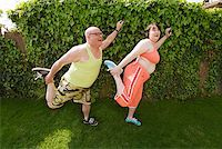fat man exercising - Couple stretching in backyard Stock Photo - Premium Royalty-Freenull, Code: 673-02142335