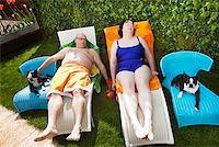fat woman in bathing suit - Couple relaxing on lawn chairs in backyard Stock Photo - Premium Royalty-Freenull, Code: 673-02142336
