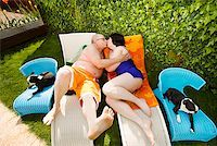 fat woman in bathing suit - Couple kissing on lawn chairs in backyard Stock Photo - Premium Royalty-Freenull, Code: 673-02142337